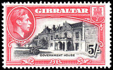 Gibraltar 1944 5/- black & carmine perf 13 mint very lightly hinged.