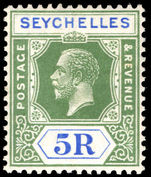 Seychelles 1921-32 5r yellow-green and blue lightly mounted mint.